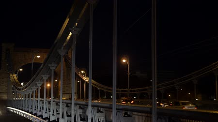metropolitano : Bridge city at night with cars walking people and bicycles