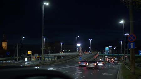 otoyol : Ambulance at Night City traffic with trams and cars Stok Video