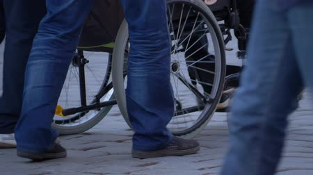 rehabilitasyon : Couple walking with wheelchair