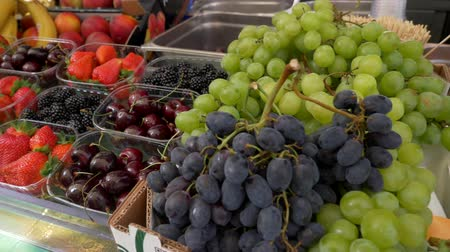 amoras : Mix of berries in plastic boxes in market ready to sell. blueberries, fig, blackberries, strawberries, grape