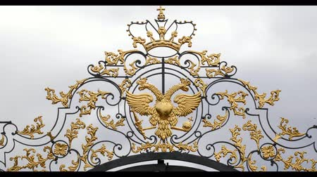 hekje : Double headed eagle the symbol of Russian Empire Luxury Golden fence gate close up slow motion