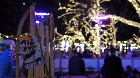 карусель : Christmas ice skating rink and sled at market square fair in Austria Viena night time with winter decoration and colourful lights Стоковые видеозаписи