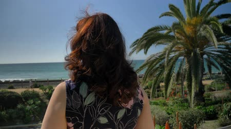 Happy woman looking around in Linda Lane Park in San Clemente California Stock Footage