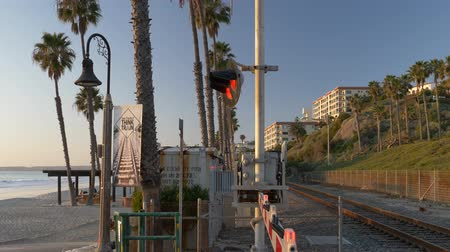 Railroad California train next to ocean pacific Surfliner in San Clemente Stock Footage