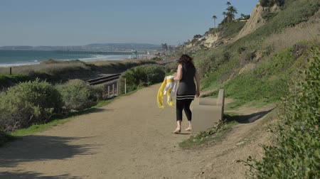 benches : Woman happy Beautiful sunny summer Day Walking ocean coast. Travel Vacation Retirement Lifestyle Concept California Orange county San clemente Stock Footage