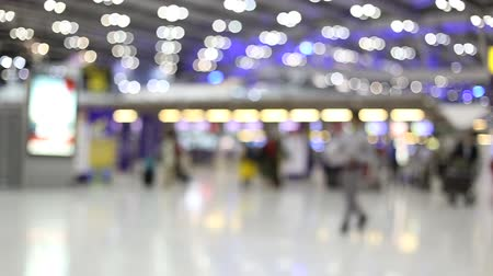 blurred people in airport.