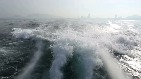 Trace tail of speed boat on water surface in the sea.