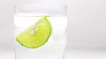Refreshing soda tonic fizzy water with lime slice in a Glass, Detox concept.