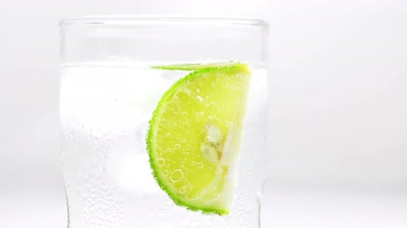 tonikum : Refreshing soda tonic fizzy water with lime slice in a Glass, Detox concept.