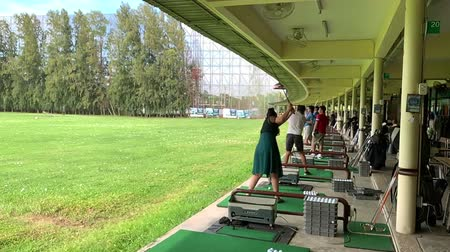 Srinakarin Bangko - Jul 27, 2019 : Slow motion of woman and man practice golf.