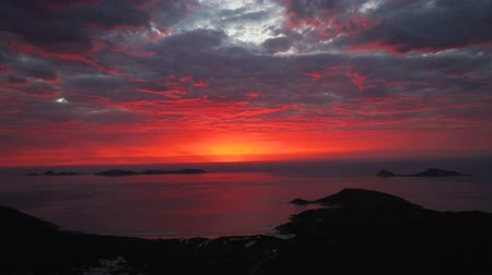 Sky on fire in Australia, red sunset over Wilsons prom and the sea