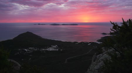 Stunning bright red sunset over Wilsons prom and squeaky beach in Australia in the summer Stock Footage