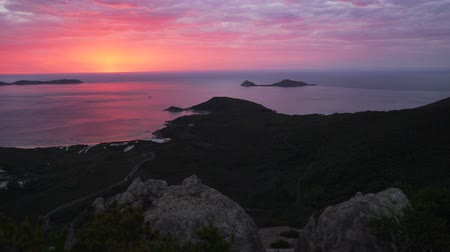 Unreal pink and purple sunset over Wilsons promontory national park in Australia