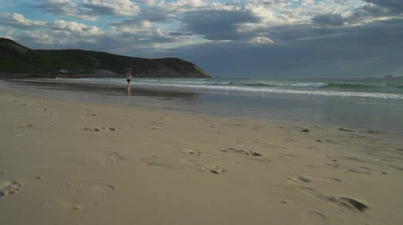 promontory : Walking on squeaky beach in Wilsons promontory in Australia, dolly in shot Stock Footage