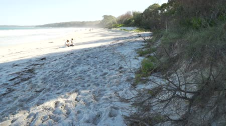 Pan move of Nelsons beach in Jervis bay in the summer, Australia Стоковые видеозаписи