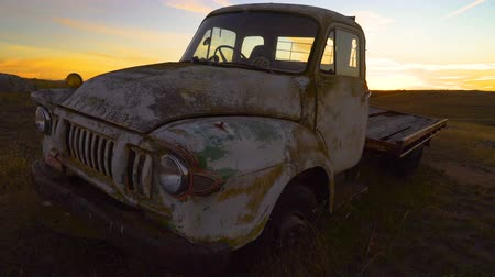 Top view of a rusty car wreck at sunset in Australia Stock Footage