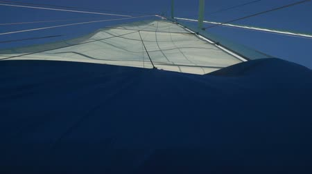 Sail going down on a monohull yacht in Australia