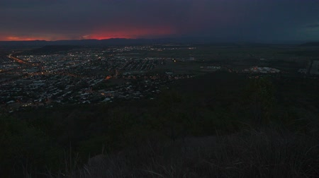 Sunset and lightnings over Townsville, Queensland, Australia, view from Castle hill Стоковые видеозаписи