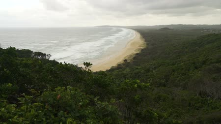 Tallows Beach in Byron Bay in Australia on a cloudy day Стоковые видеозаписи