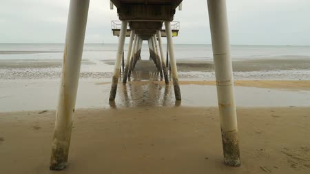 View from below a pier in Torquay, Queensland, Australia