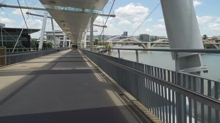 Walking on Kurilpa bridge in Brisbane in the summer, Australia Stock Footage