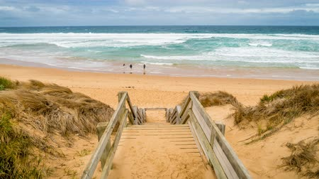 targi : Stairs going down to the beach in Woolamai on Phillip island in Australia, zoom in