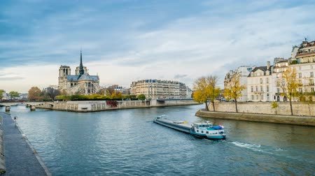senki : Notre-dame-de-Paris, the Seine river and a boat in Paris in autumn, zoom in