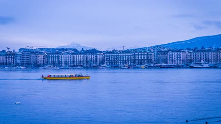 geneva : Red and yellow Boat crossing the Geneva lake, zoom in Stock Footage