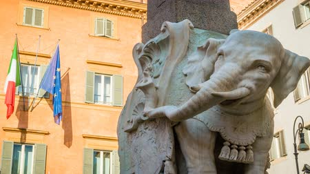 город : Statue depicting an elephant in Rome with the italian and european union flag, zoom in