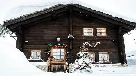 cabins : Chalet covered with snow and decorated for Christmas, zoom in Stock Footage
