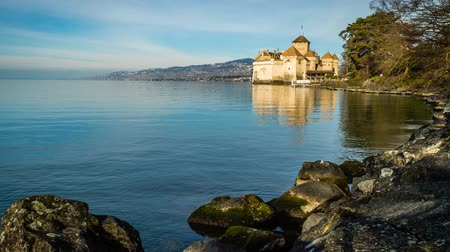 geneva : Chillon castle at dawn in the winter with rocks in the foreground, zoom in