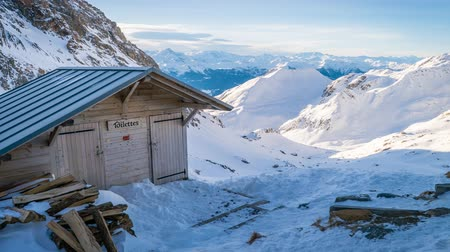 alpes : Toilets in the Presset refuge in the winter in France, zoom in Stock Footage