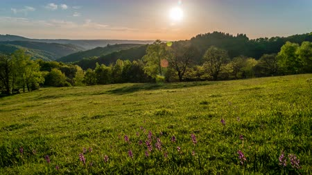 hegytömb : Sunset in the Massif Central mountains in France, Lot and Occitanie region, timelapse in the summer. Stock mozgókép