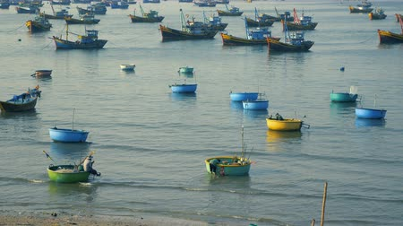 Some Fhisherman in Mui Ne, fishing village in Vietnam, Colorful boats