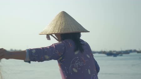 Fisherwoman working in village fisherman, Mui Ne, Vietnam