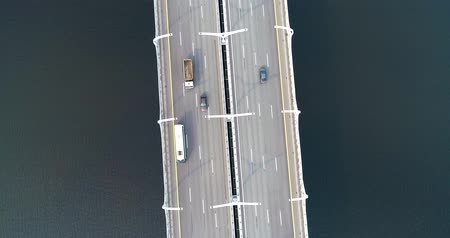 multiple lane : Aerial view of highway in the ocean. Cars crossing bridge interchange overpass. Highway interchange with traffic. Aerial highway. Expressway. Road junction. Car in motion. Bridge with traffic
