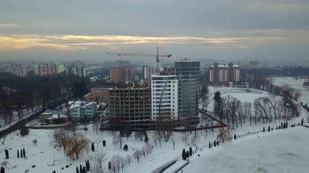 резиденция : Aerial view of high modern residential building and tower crane under construction.