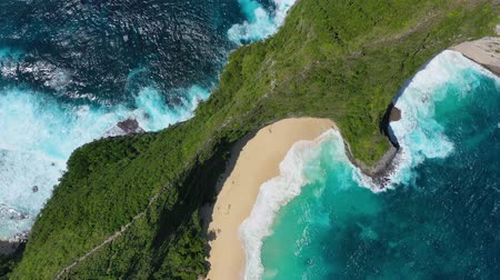 clear water beach : Coast as a background from top view. Turquoise water background from top view. Summer seascape from air. Bali island, Indonesia. Travel - video