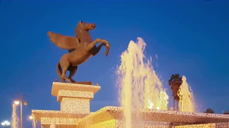 pegaz : Corinth, Greece, 5 October 2017. Blue hour of statue Pegasus at Corinth in Peloponnese in Greece.