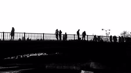 traverse : Trikala bridge with people silhouettes in black and white.