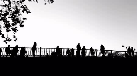 traverse : Trikala bridge in Greece with people silhouettes in black and white.