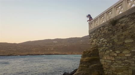 hora : Woman in Andros island in Greece seeing the view in slow motion. Stock Footage