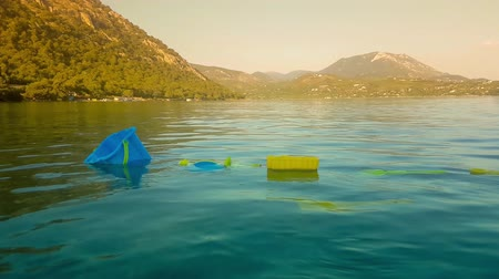 sós : Kid toys floating in the sea. Concept of sadness and sorrow after someone drowned.