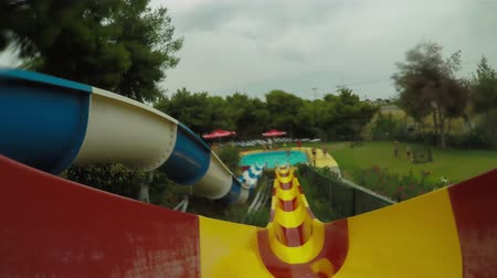 waterslide : Action camera following the motion of the sliding at waterslides. Stock Footage
