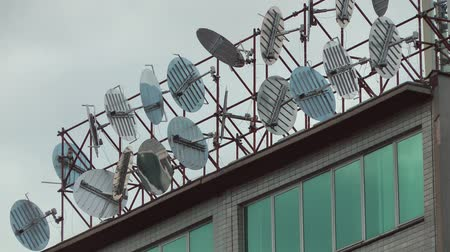 blight : Television Satellite Dishes Receivers on a rooftop Stock Footage