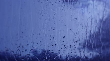 okno : Rain drops on window, blue natural background