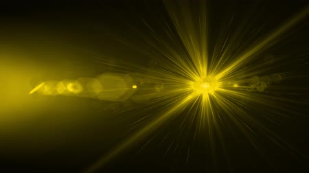 csík : bright yellow light flares abstract background