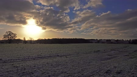 anglia : morning sunrise over winter countryside landscape time lapse