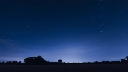 wipe away : night time star trails silhouette landscape