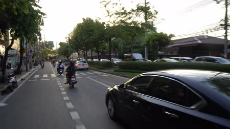 rider : The view from taking motorcycle taxi at 5 pm on Rama 4 road, Kluaynamtai area, Bangkok, Thailand in the month of June, year 2017